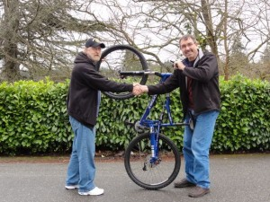 Mike the Mechanic delivers a refurbished mountain bike to a veteran.