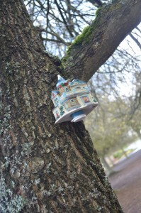This geocache is fashioned onto a tree in Tacoma in a busy shopping plaza. Inside this porcelain house is a logbook for geocachers to sign.