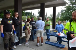 Geocacher Hooovers69 (center) hosts a Cache In Trash Out clean-up event at for fellow cachers at the Dawson Playfield in Tacoma.