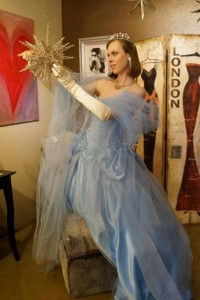 Caroline Donovan, an employee at Northwest Costume, appropriately hangs a star while dressed as the Blue Fairy.