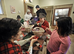 Volunteers at the Living History Museum engage visitors in activities of yore. Photo by Russ Carmack.