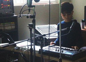 Playing music has helped Lucien manage with some of the challenges of autism.