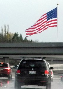 The Tacoma Screw Products flag sits in the windshield view of thousands of commuters along State Route 16 all day, every day. Photo by Steve Dunkelberger.