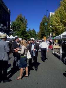 Locals enjoy the sunshine and peruse the vendors at the Tacoma Farmers Market on Broadway Street held every Thursday in the summer.