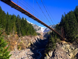 The Tahoma Creek Suspension Bridge swings for 200 feet, supported only by cables and a wooden walkwayPhoto by Douglas Scott.