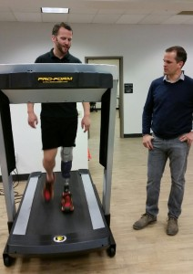 Ryan works with patient Nick Roumonada, an Iron Man Triathlete, on his new test prosthesis.