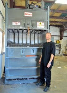 """Frank Klass demonstrates how the spring coils of the disassembled mattresses are compressed for recycling. Klass and many other employees at Spring Back Mattress Recycling are able to """"spring back"""" from hard circumstances through this environmentally conscious job opportunity."""