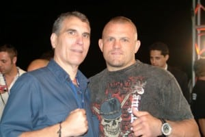 Brian Halquist (left) with former UFC world champion Chuck Liddell (right).