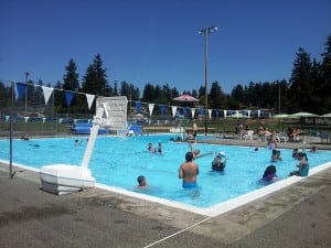 Residents enjoy a cool swim during the summer heat at the community pool in Fircrest outside Tacoma.  Photo credit: Sonia Garza.