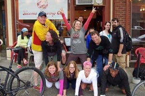 Bike and brew enthusiasts pose outside of Tacoma Brewing Company. Photo credit: Ron Swarner.