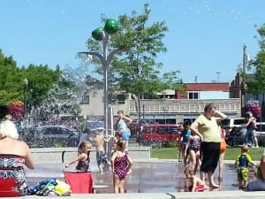 Kiddos enjoy splashing at the newest splash park to the South Sound in downtown Puyallup's Pioneer Park. Photo credit: Sonia Garza.