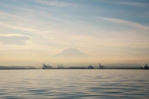 Stunning Mount Rainier is the backdrop to Tacoma's bustling, industrial port. Photo credit: Aaron Jorgenson.