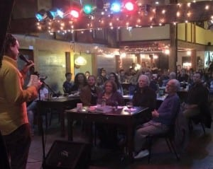 B Sharp Coffee House is filled to the brim with guest emcee, King's Books Sweet Pea on stage.