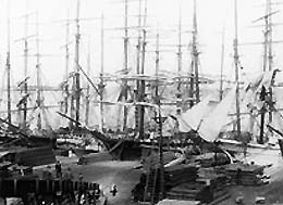 Sailing vessels loading lumber, Tacoma waterfront, ca. 1887. Photo credit: E. A. Lynn, courtesy UW Special Collections (Neg.UW5367).
