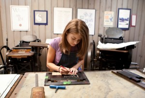 Former student Caitlin Harris setting type at the Elliott Press. Harris went on to found Wheelhouse Press in Portland, Oregon. Photo courtesy: PLU School of Arts and Communication.