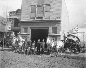 "In 1890, Tacoma Fire Dept. Station # 3 was at 1212 North ""G"", near the corner of ""G"" and McCarver Streets. The station had a Silsby patent, fourth class rotary engine weighing in at 7,000 pounds which was drawn by two horses. Photo courtesy: Tacoma Public Library."