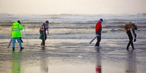 clam diggers on beach