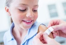 Kaiser Permanente Flu Season Child with Bandaid